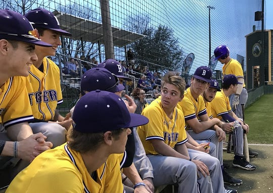 The Benton bench reacts to play Friday night in the Jason Bland Memorial Baseball Tournament against Captain Shreve.