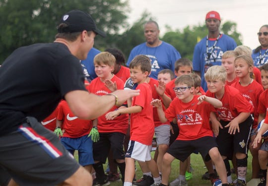 Saints quarterback Drew Brees talks to youth at one of his Football 'N' America events.