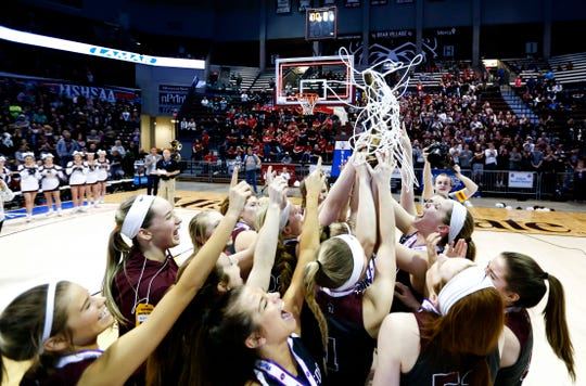 The Strafford Lady Indians celebrate their win over the Lutheran North Crusaders to win in the Class 3 state championship game at JQH Arena on Friday, March 8, 2019. Strafford won four consecutive state championships and has 115 straight wins.