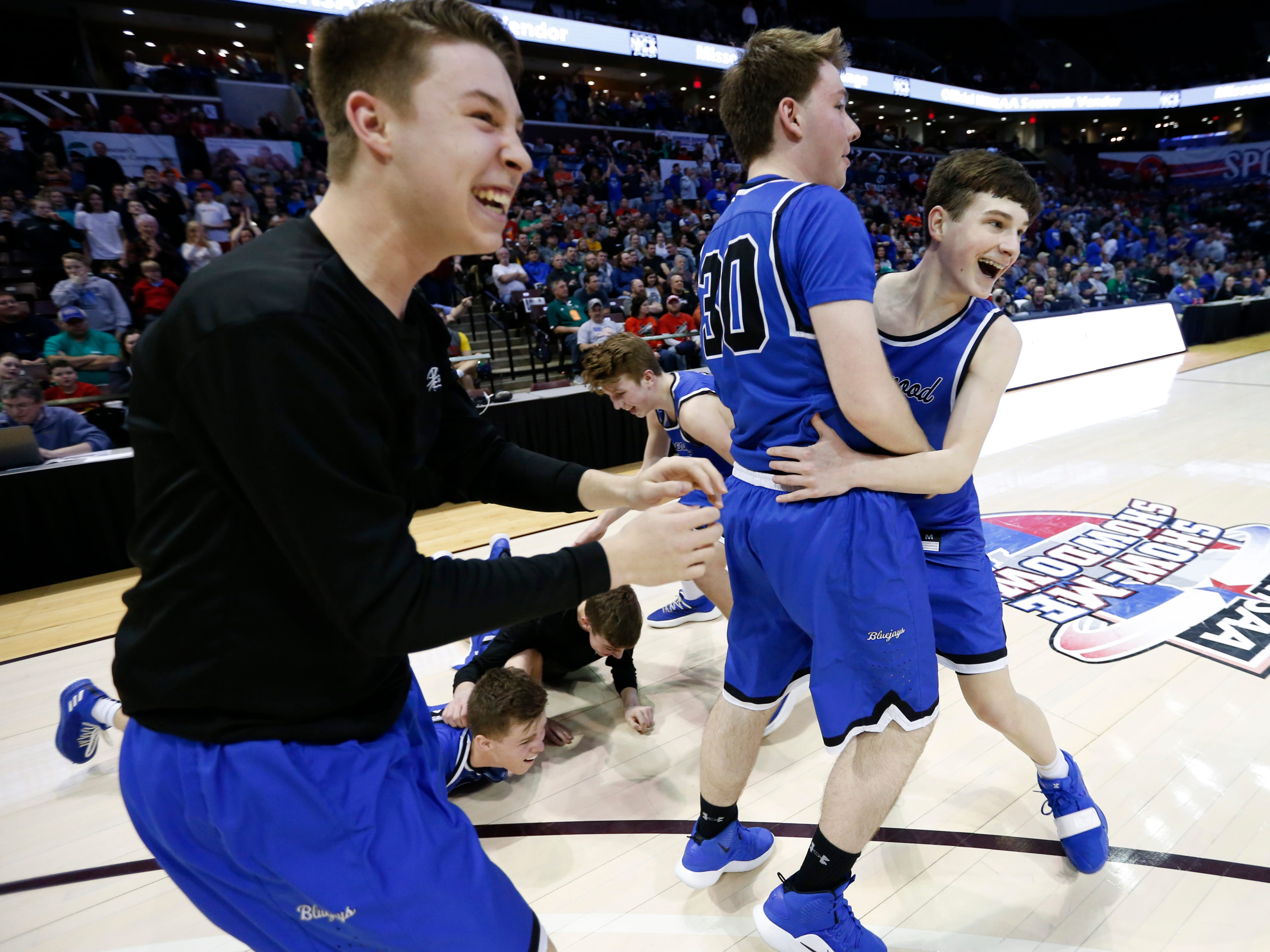 Greenwood Blue Jays Grant Harper (right), Tate Dukewits (center) and Cooper Clark storm the court in celebration after beating the Oran Eagles 55-54 to win the Class 2 state championship game at JQH Arena on Saturday, March 9, 2019.
