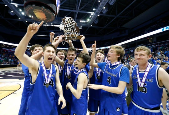 The Greenwood Blue Jays hoist the Class 2 state championship trophy after beating the Oran Eagles to win the title game 55-54 at JQH Arena on Saturday, March 9, 2019.