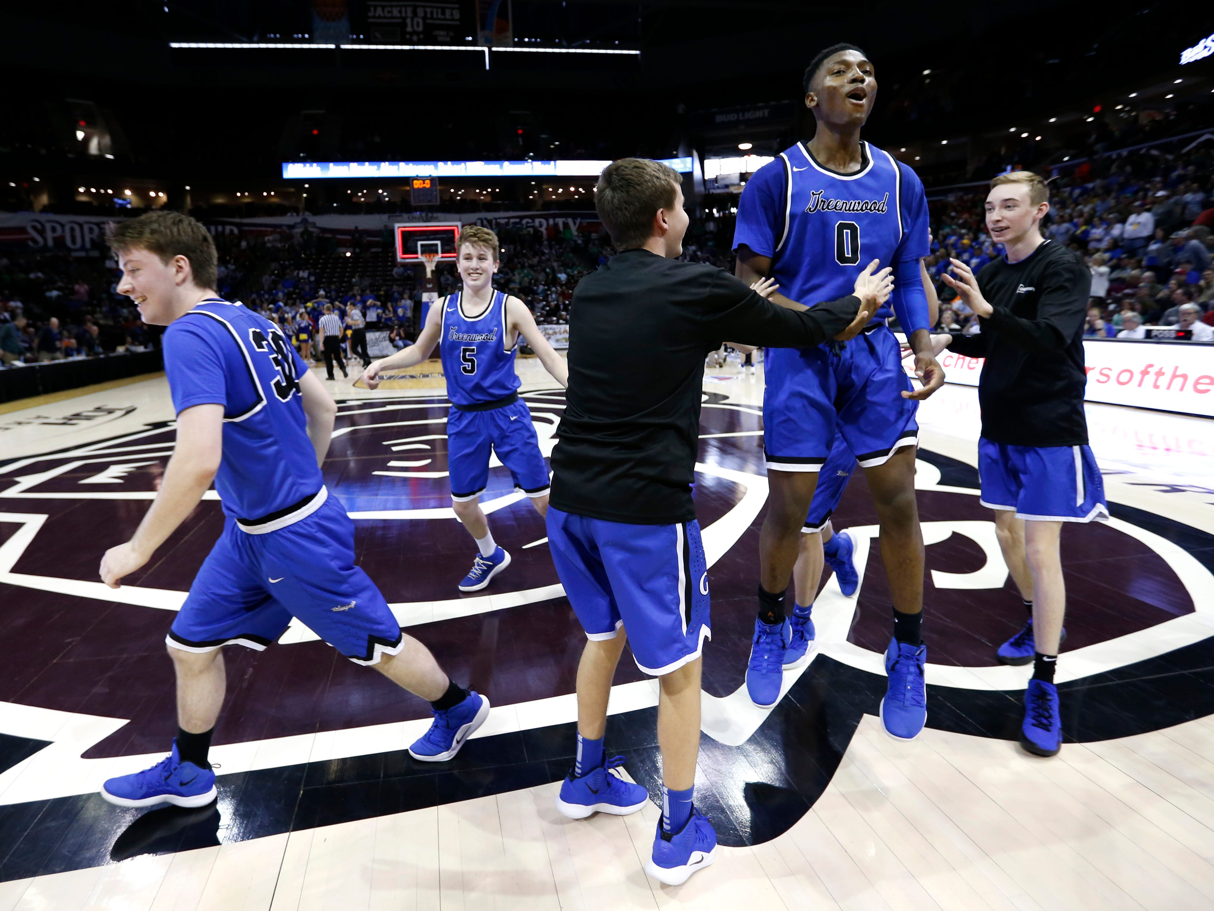 The Greenwood Blue Jays storm the court in celebration after beating the Oran Eagles 55-54 to win the Class 2 state championship game at JQH Arena on Saturday, March 9, 2019.