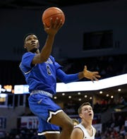 Greenwood Blue Jay Aminu Mohammed carries the ball up for a field goal during the Class 2 state championship game against the Oran Eagles at JQH Arena on Saturday, March 9, 2019.