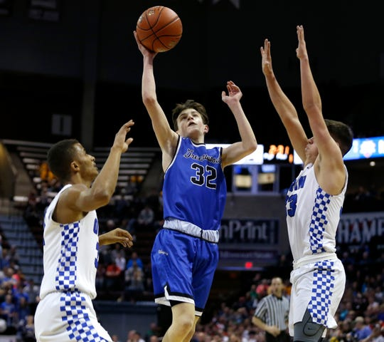 Greenwood Blue Jay Grant Harper carries the ball up for a field goal during the Class 2 state championship game against the Oran Eagles at JQH Arena on Saturday, March 9, 2019.
