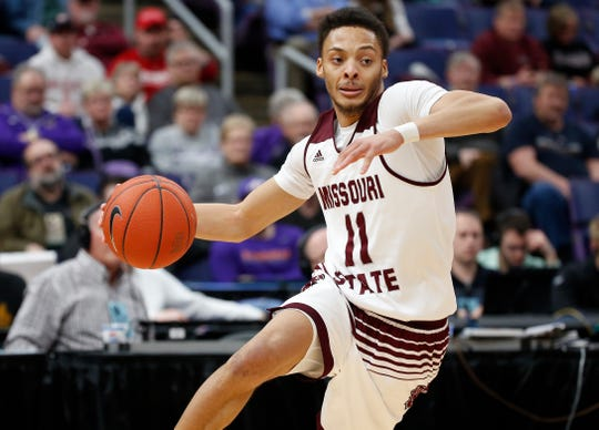 Missouri State's Jarred Dixon (11) drives the ball against Bradley, Friday, March 8, 2019, at the Enterprise Center in St. Louis.