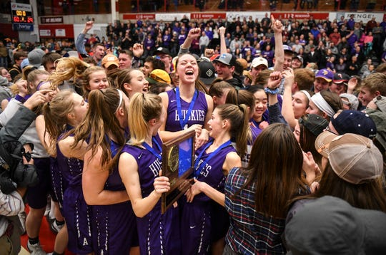 Albany players celebrate their 60-29 win following the Section 6-2A championship game against Pine City Friday, March 8, at Halenbeck Hall in St. Cloud. Albany won 60-29.