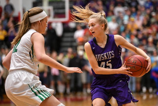 Albany's Rachael Neu protects the ball during the Section 6-2A championship game against Pine City Friday, March 8, at Halenbeck Hall in St. Cloud.
