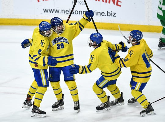 St. Cloud Cathedral's Jackson Savoie and teammates celebrate during the state tournament championship game Saturday, March 9, 2019 at the Xcel Energy Center in St. Paul.