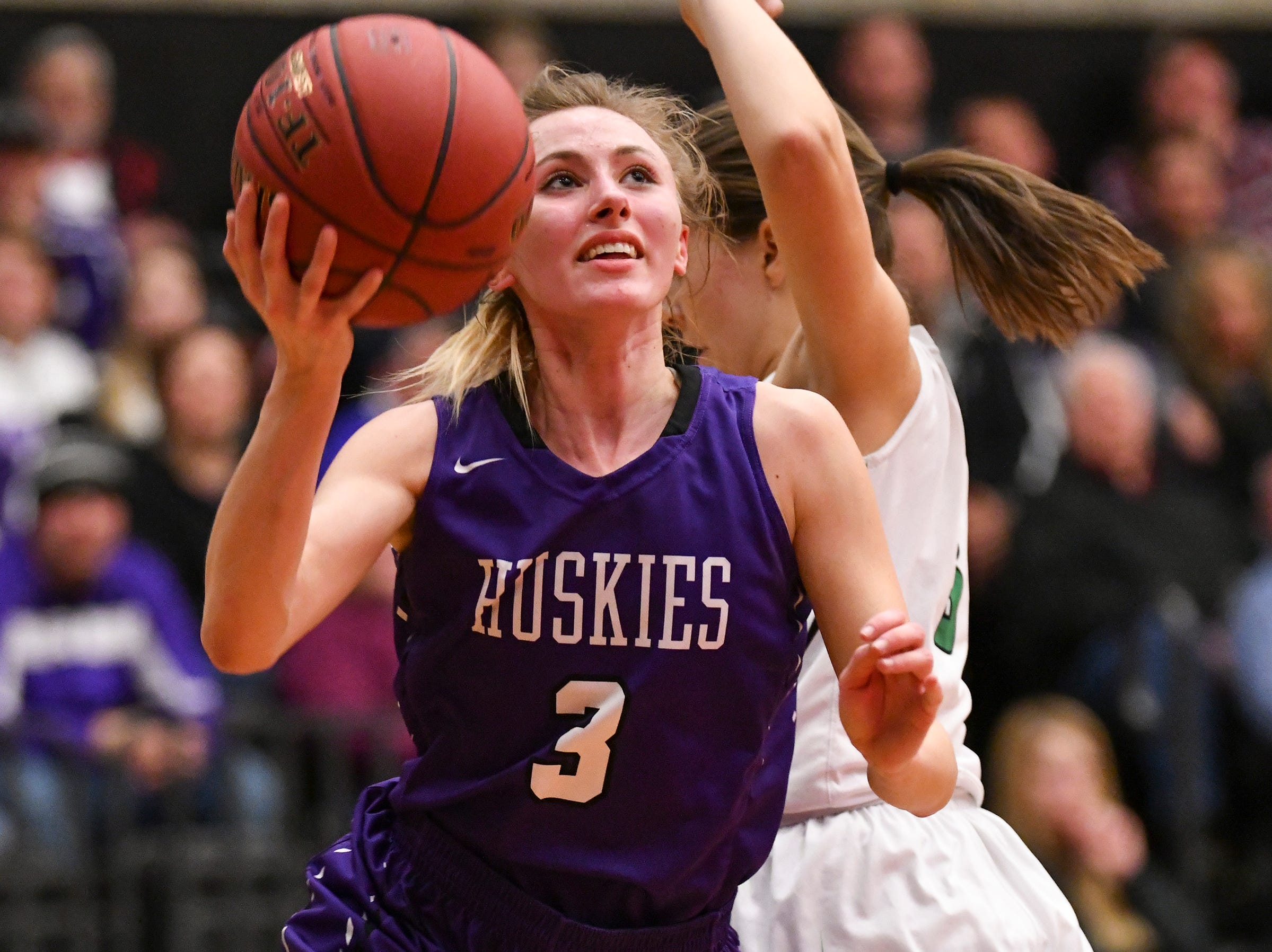 Albany's Amanda Kollodge eyes the basket during the Section 6-2A championship game against Pine City Friday, March 8, at Halenbeck Hall in St. Cloud.