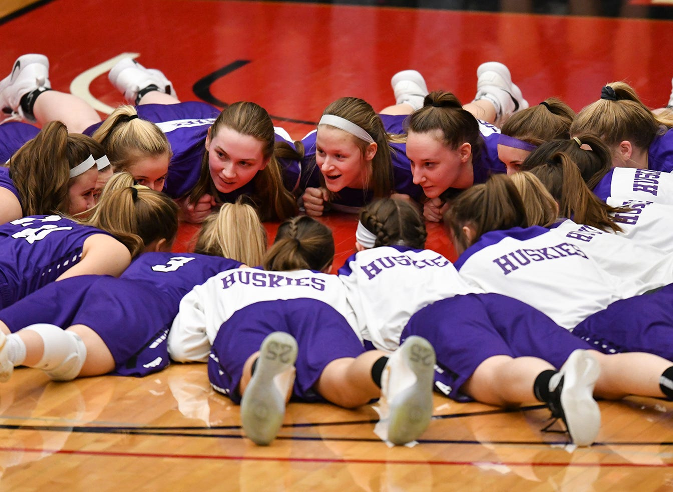 Albany players gather before the start of  the Section 6-2A championship game against Pine City Friday, March 8, at Halenbeck Hall in St. Cloud.
