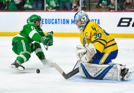 Cathedral's Noah Amundson concentrates on the puck  during the state Class A championship game Saturday, March 9, 2019, at the Xcel Energy Center in St. Paul.
