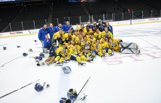Cathedral players pose for photographs with their first place trophy following their 5-2 win against Greenway in the state Class A championship game Saturday, March 9, 2019, at the Xcel Energy Center in St. Paul.