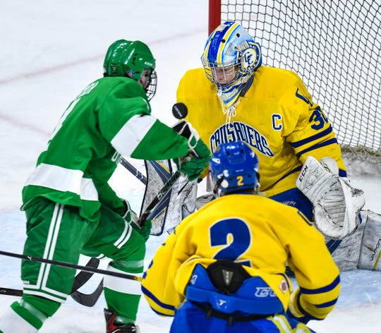 Cathedral' Noah Amundson makes a save during the state Class A championship game Saturday, March 9, 2019, at the Xcel Energy Center in St. Paul.