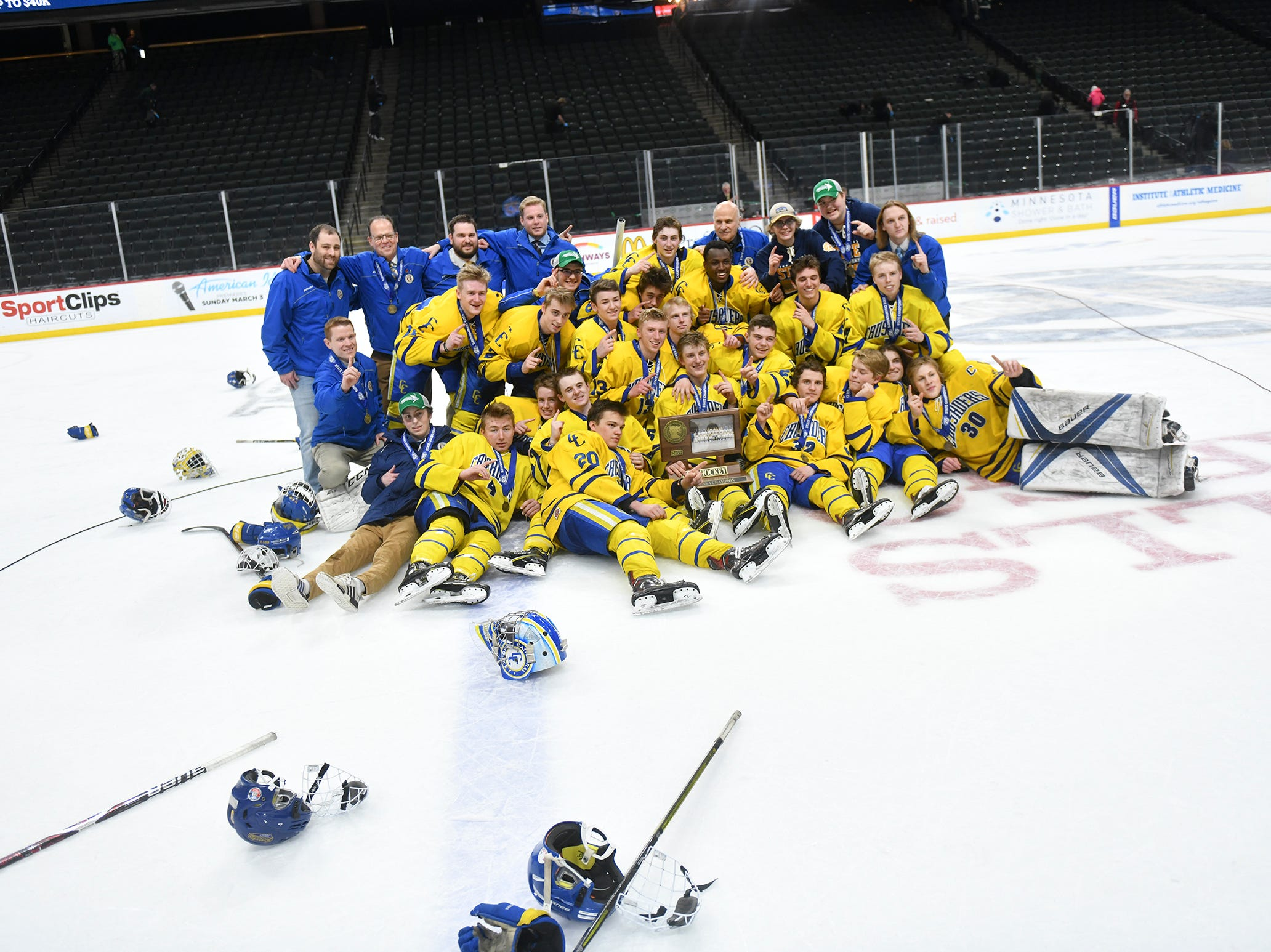 Cathedral' players pose for photographs with their first place trophy following their 5-2 win against Greenway in the state Class A championship game Saturday, March 9, 2019, at the Xcel Energy Center in St. Paul.