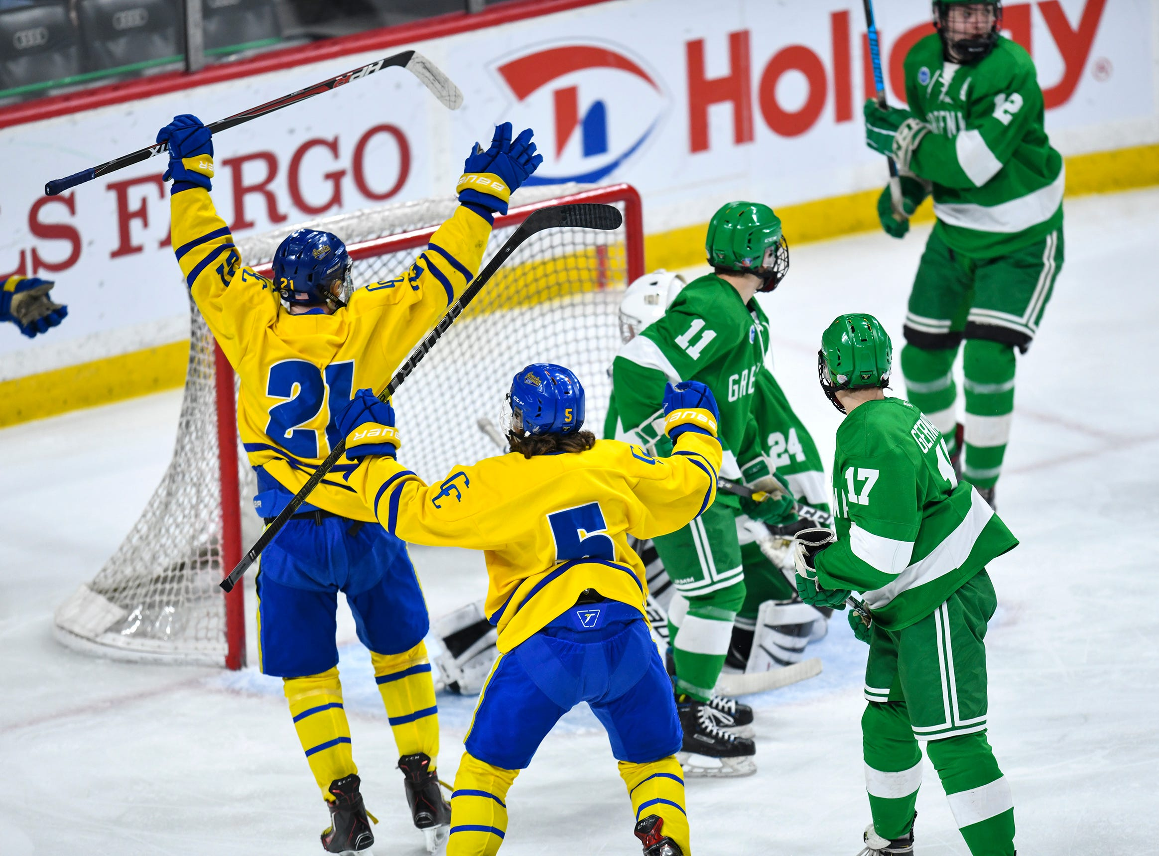 Cathedral players celebrate a first period goal during the state Class A championship game Saturday, March 9, 2019, at the Xcel Energy Center in St. Paul.