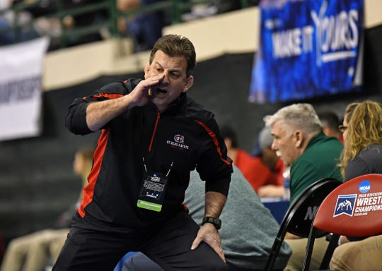 St. Cloud State wrestling coach Steve Costanzo advises a competitor at the 2019 NCAA Division II championships Friday in Cleveland, Ohio.