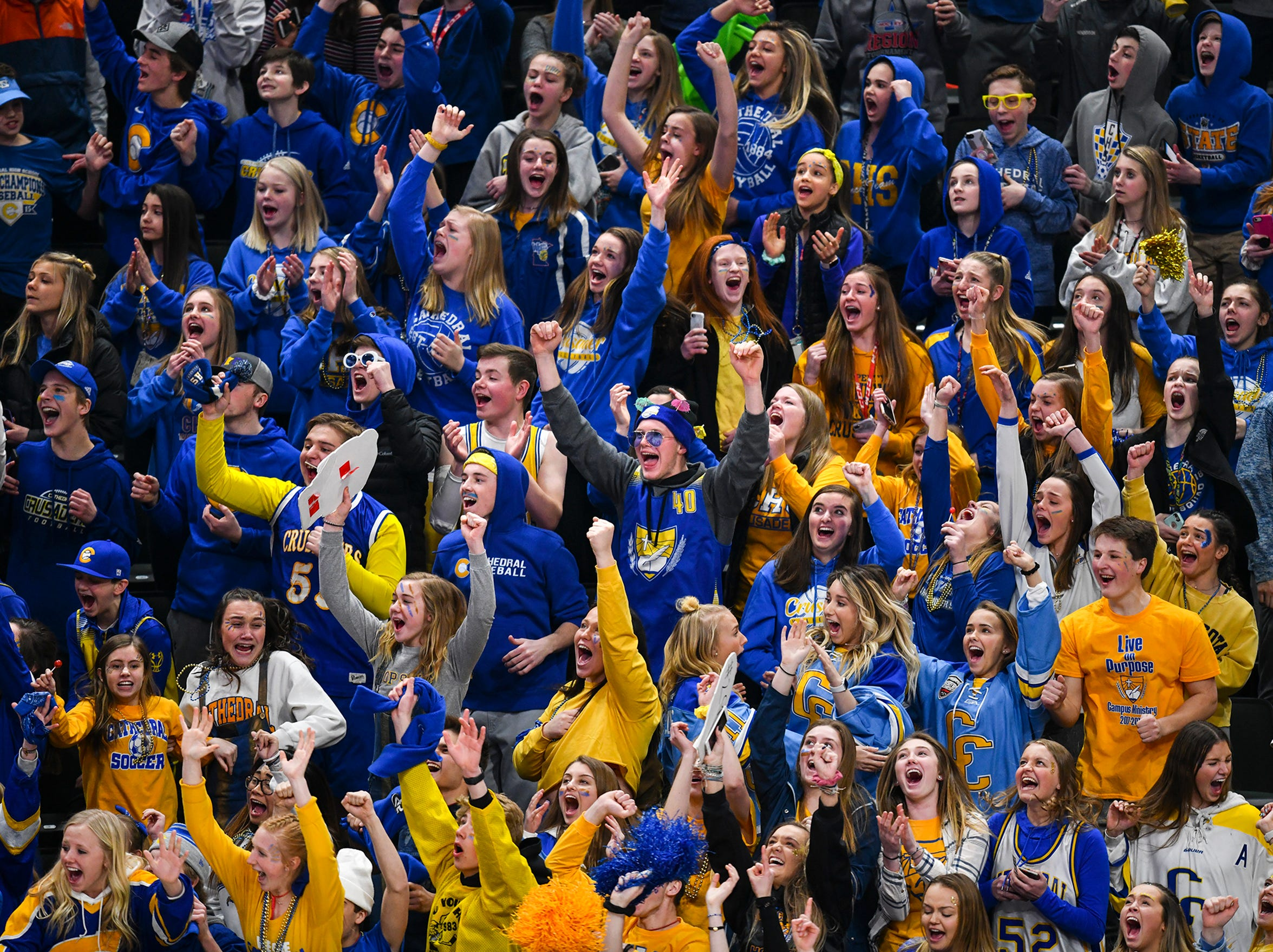Cathedral fans cheer following a third quarter goal by their team during the state Class A championship game Saturday, March 9, 2019, at the Xcel Energy Center in St. Paul. Cathedral won the state championship with a 5-2 win against Greenway.