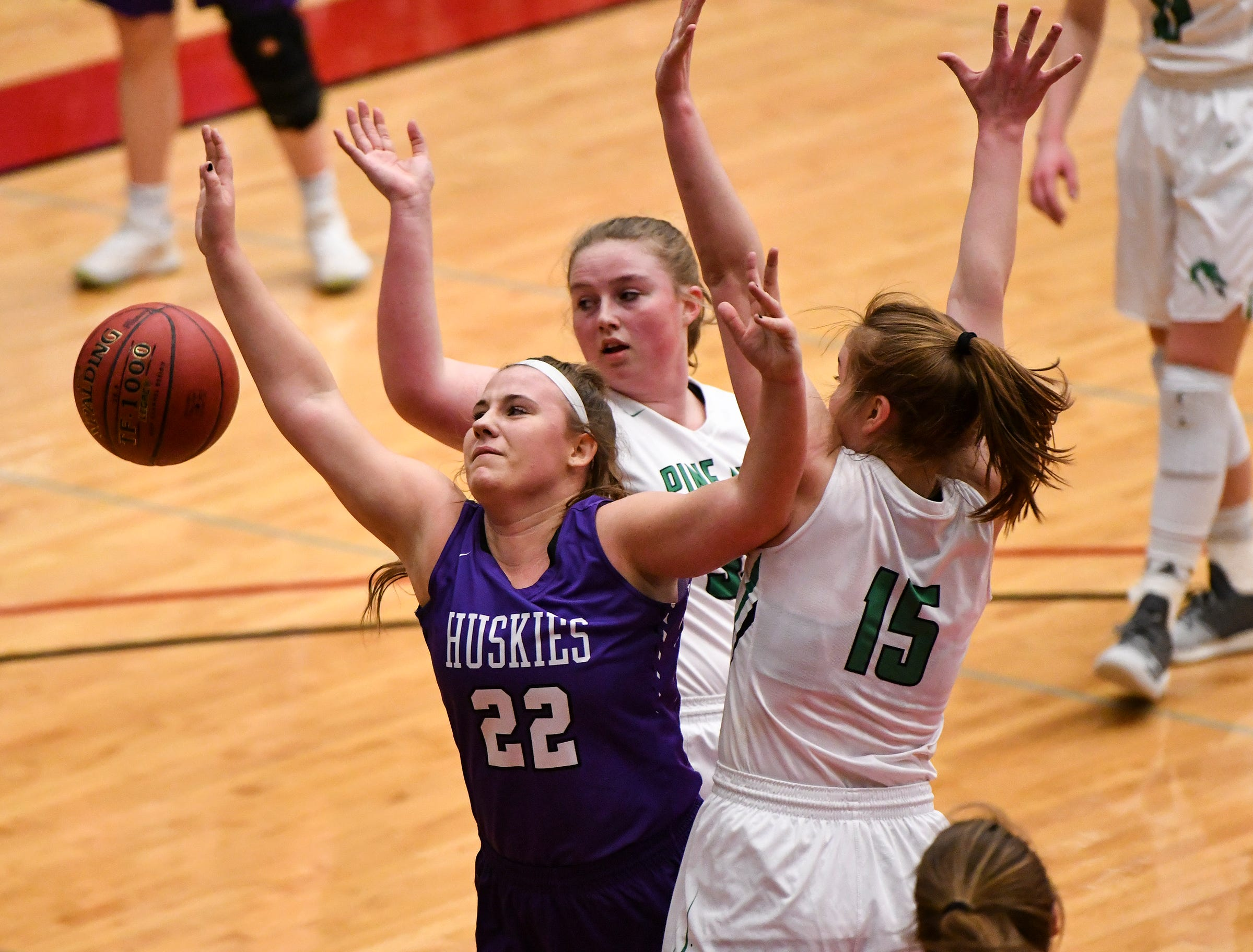 Albany's Breanna Mellesmoen drives to the basket during the Section 6-2A championship game against Pine City Friday, March 8, at Halenbeck Hall in St. Cloud.