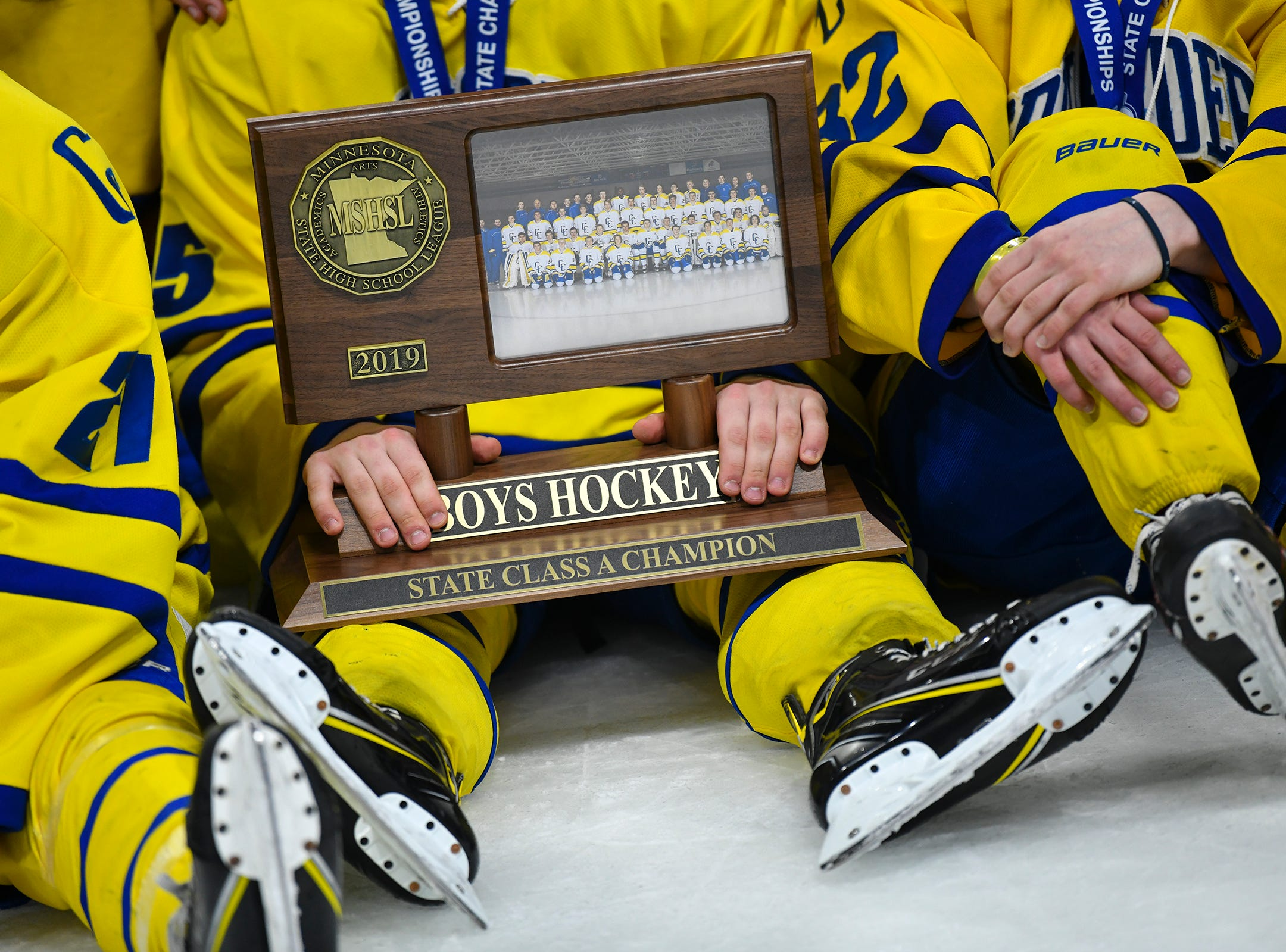 Cathedral players hold their first place trophy following the state Class A championship game Saturday, March 9, 2019, at the Xcel Energy Center in St. Paul.