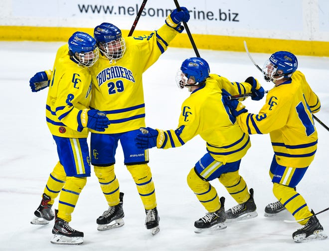 Cathedral players celebrate a goal by Jackson Savoie during the state Class A championship game Saturday, March 9, 2019, at the Xcel Energy Center in St. Paul.