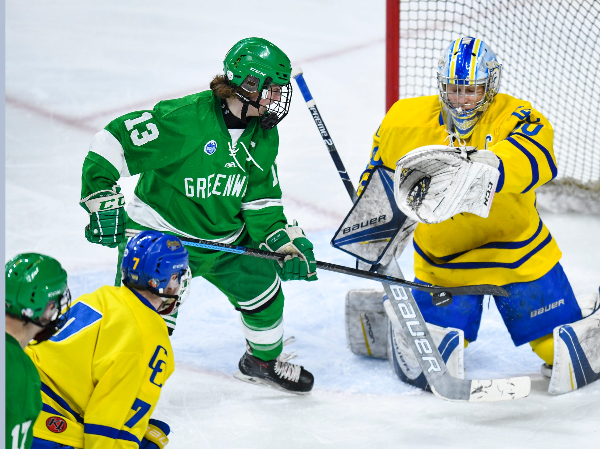 Cathedral goaltender Noah Amundson makes a save during the state Class A championship game Saturday, March 9, 2019, at the Xcel Energy Center in St. Paul.