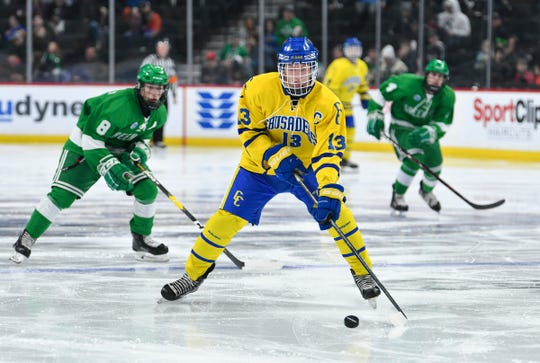 Cathedral's Talon Lenzen skates with the puck during the state Class A championship game Saturday, March 9, 2019, at the Xcel Energy Center in St. Paul.