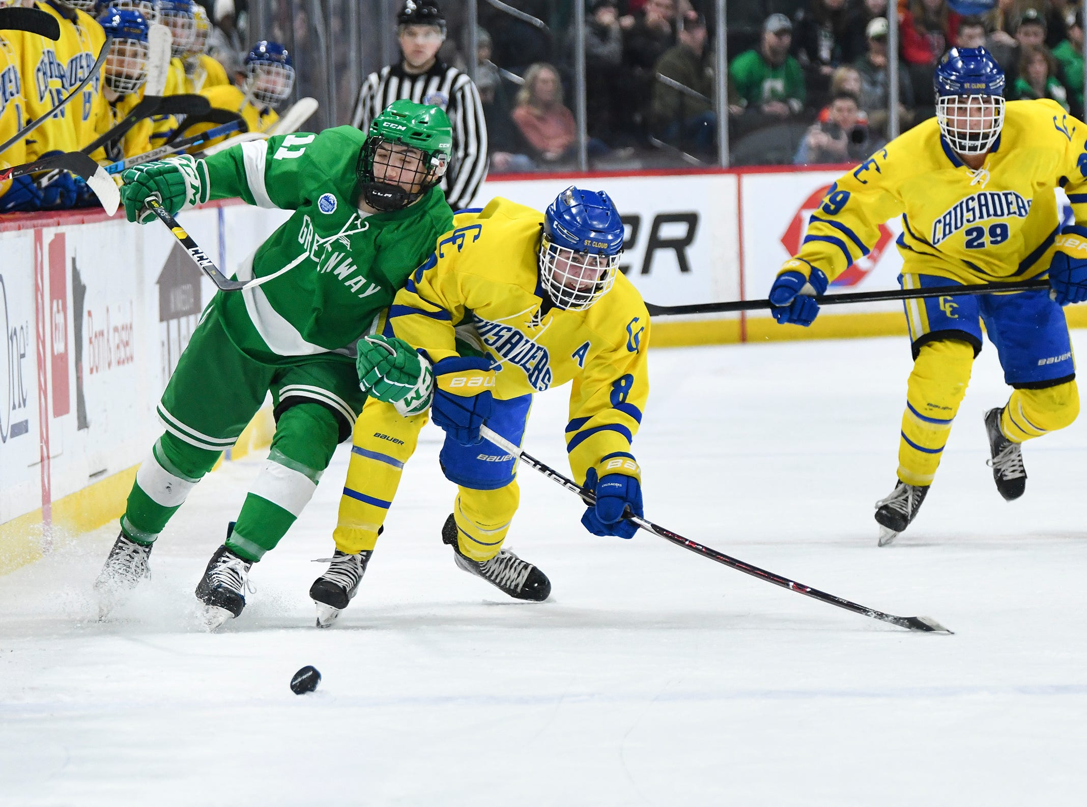 Players battle for control of the puck during the state Class A championship game Saturday, March 9, 2019, at the Xcel Energy Center in St. Paul.