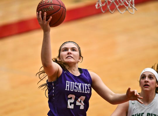 Albany's Paige Meyer takes a shot  in the first half during the Section 6-2A championship game against Pine City Friday, March 8, at Halenbeck Hall in St. Cloud.