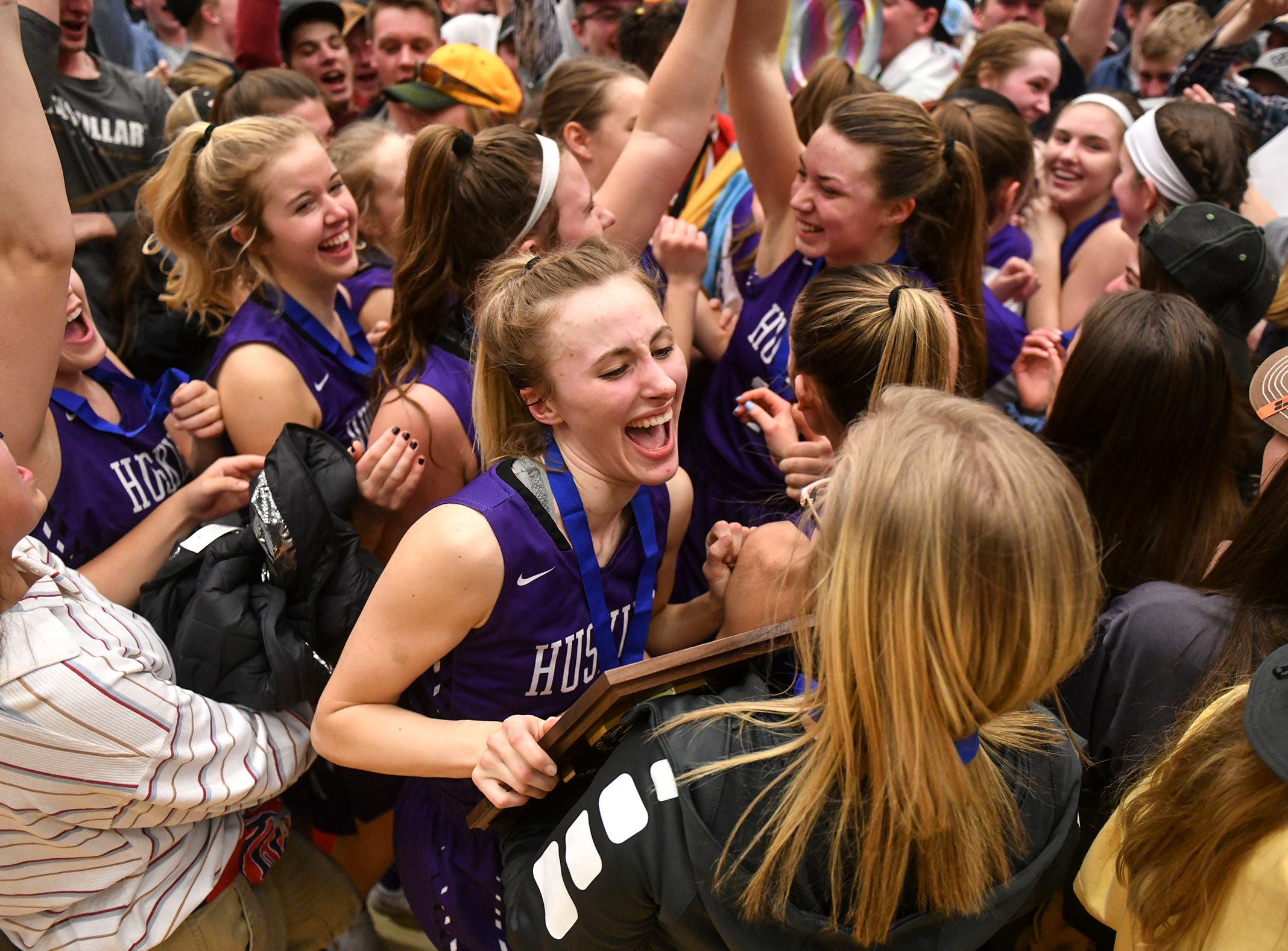 Albany players celebrate with their fans following the Section 6-2A championship game against Pine City Friday, March 8, at Halenbeck Hall in St. Cloud. Albany won 60-29.