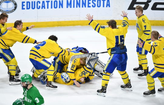 Cathedral' players celebrate their 5-2 win against Greenway during the state Class A championship game Saturday, March 9, 2019, at the Xcel Energy Center in St. Paul.