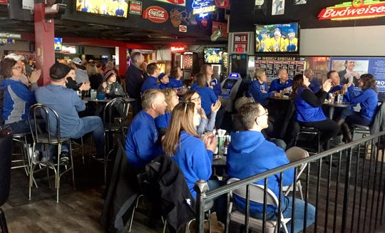 Fans watch the Cathedral vs. Greenway state championship hockey game Saturday, March 9 at H.R. Pesty's Saloon in Waite Park.