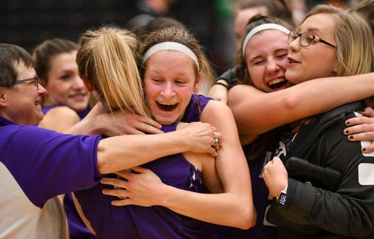 Albany players share hugs following the Section 6-2A championship game against Pine City Friday, March 8, at Halenbeck Hall in St. Cloud. Albany won 60-29.