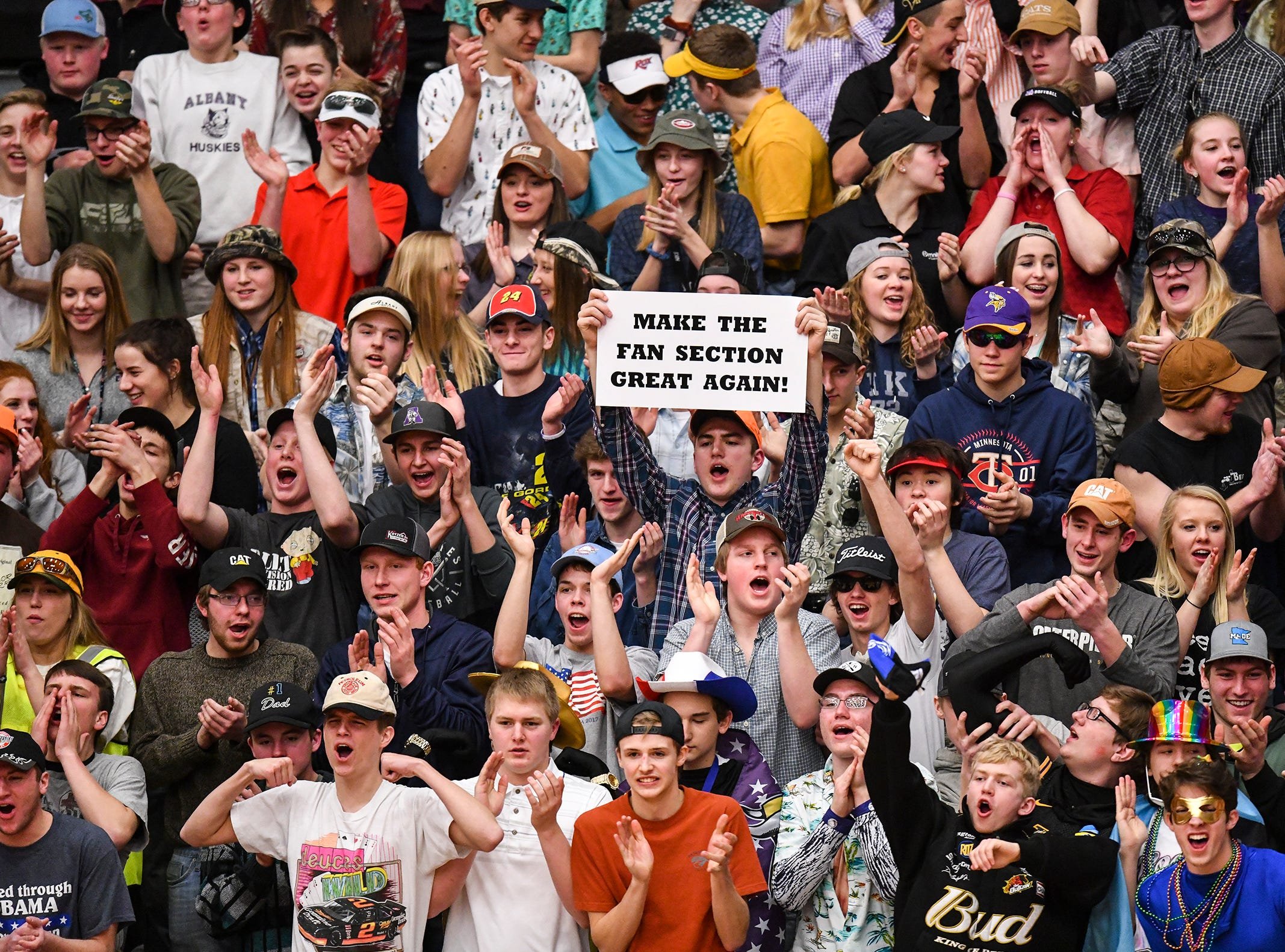 The Albany student section cheers for their team during the Section 6-2A championship game against Pine City Friday, March 8, at Halenbeck Hall in St. Cloud.