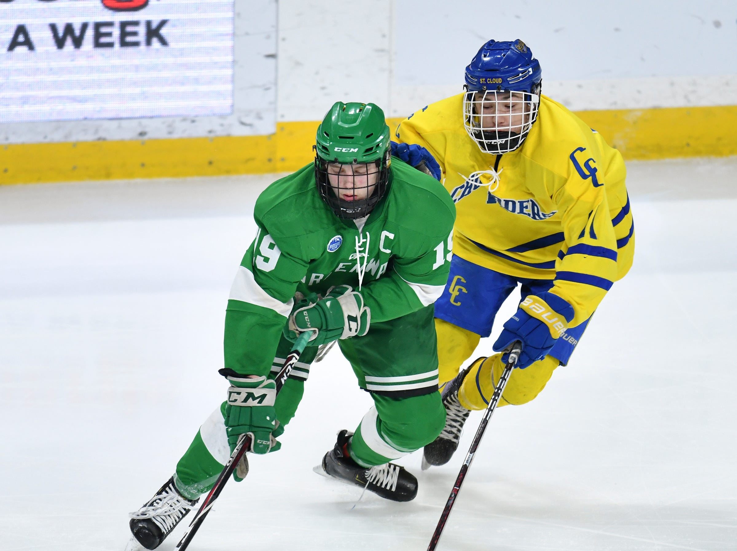 Cathedral's Ethan Cumming works against Greenway's Nikolai Rajala  during the state Class A championship game Saturday, March 9, 2019, at the Xcel Energy Center in St. Paul.
