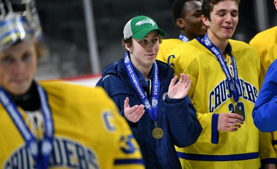Cathedral manager Cade Anderson celebrates with his teammates following the state Class A championship game Saturday, March 9, 2019, at the Xcel Energy Center in St. Paul.