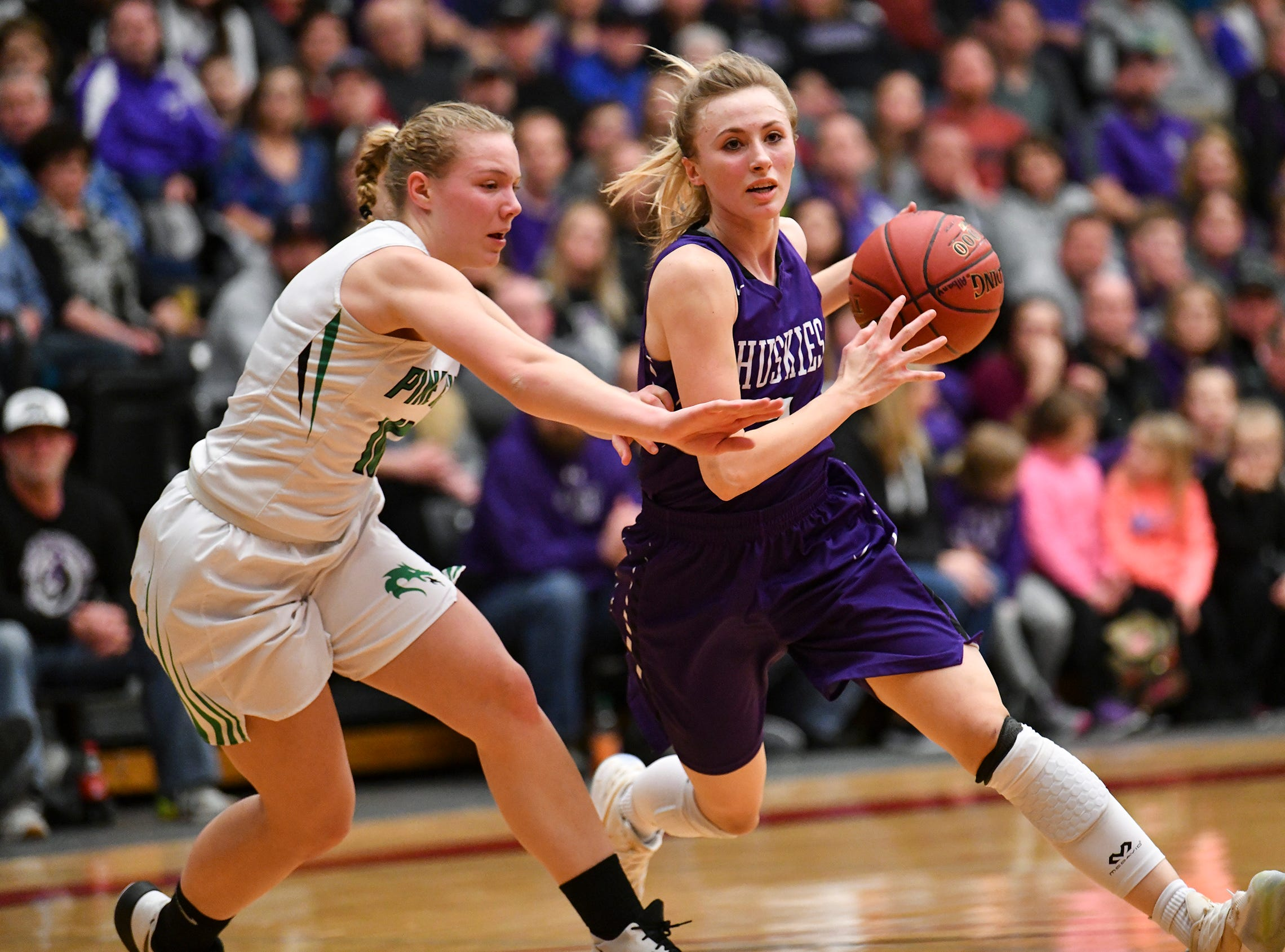 Albany's Amanda Kollodge works with the ball during the Section 6-2A championship game against Pine City Friday, March 8, at Halenbeck Hall in St. Cloud.