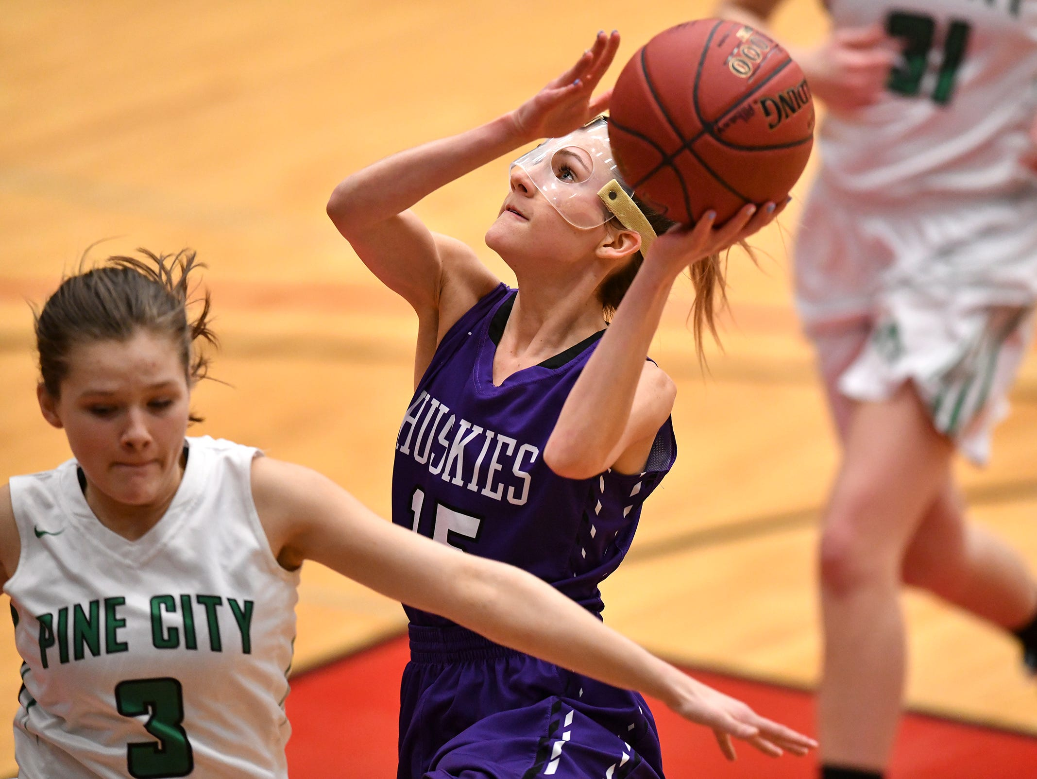 Albany's Paige Rueter puts up a shot  during the Section 6-2A championship game against Pine City Friday, March 8, at Halenbeck Hall in St. Cloud.