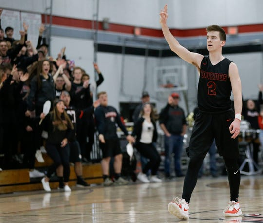 Lourdes Academy's Henry Noone (2) reacts after hitting a 3-pointer against Marathon in a Division 4 sectional final Saturday at Neillsville High School.