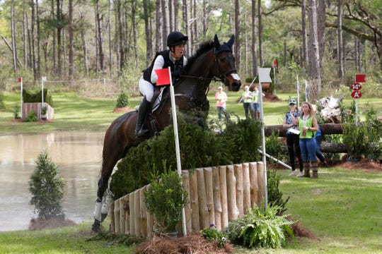 Maya Black (93) jumps a skinny a riding FE Black Ice. Riders compete in the cross country event at the Red Hills International Horse Trials Saturday, March 9, 2019.