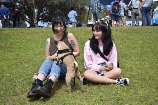 Sierra Thomas, left, Pickle and Harley Newsome enjoy Revolution Gelato Saturday at the 5th annual North Florida VegFest.