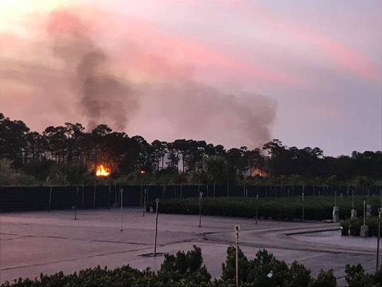 Martin County Fire Rescue crews were battling a 5- to 10-acre wildfire Friday evening, March 8, 2019, at Southeast Darling Street near Port Salerno.