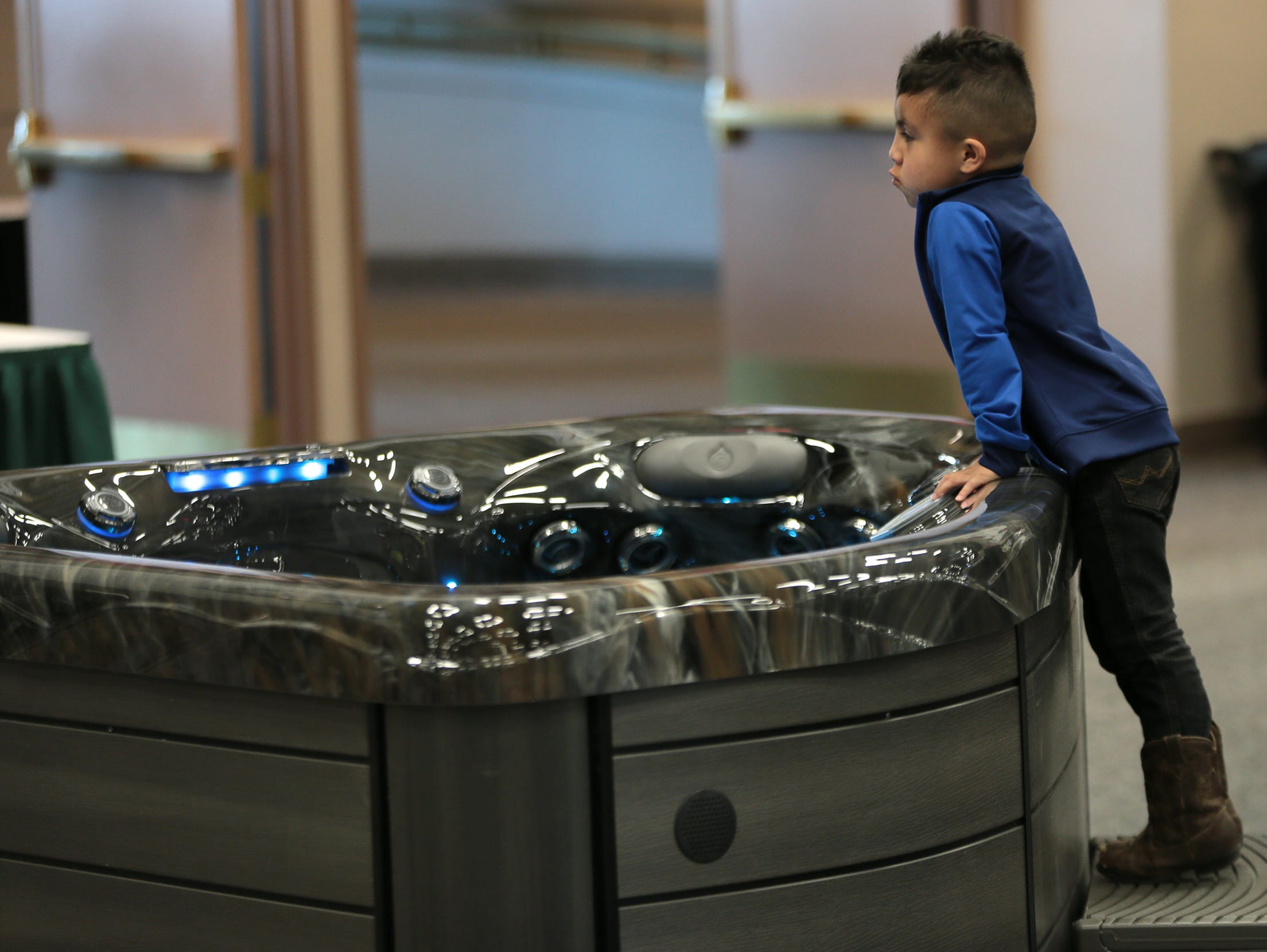 A boy ponders over a hot tub at the 19th Annual El Paso Home and Garden Show on Saturday, March 9, 2019, at the convention center in Downtown. it continues Sunday from 11 a.m. to 5 p.m.