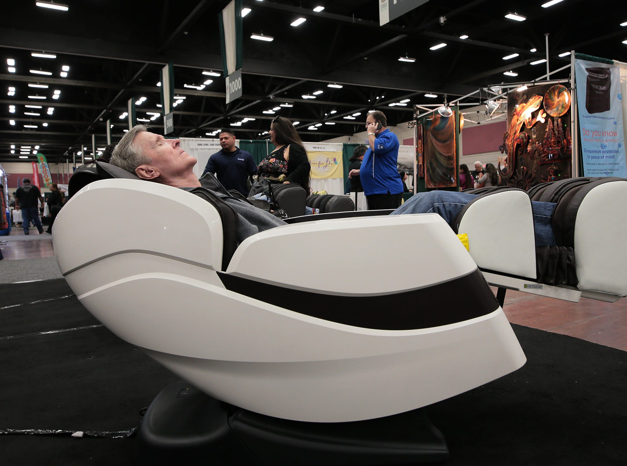 A man relaxes in a high-tech recliner at the 19th Annual El Paso Home and Garden Show, which was in full swing Saturday, March 9, 2019, at the convention center in Downtown. Find anything for your home from art to air conditioning. The show continues Sunday from 11 a.m. to 5 p.m. Tickets are $7 for people 17 and older; $6 for those 65 and older. Active military with ID and people 16 and younger get in free.
