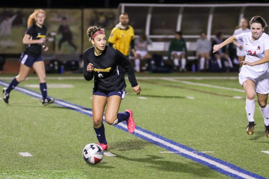 Newbury Park's Fiona Marangola switches the play on Friday night during the Ventura County versus Los Angeles County Senior Girls Soccer All-Star game at Oaks Christian's Thorson Stadium. Ventura County won, 1-0.