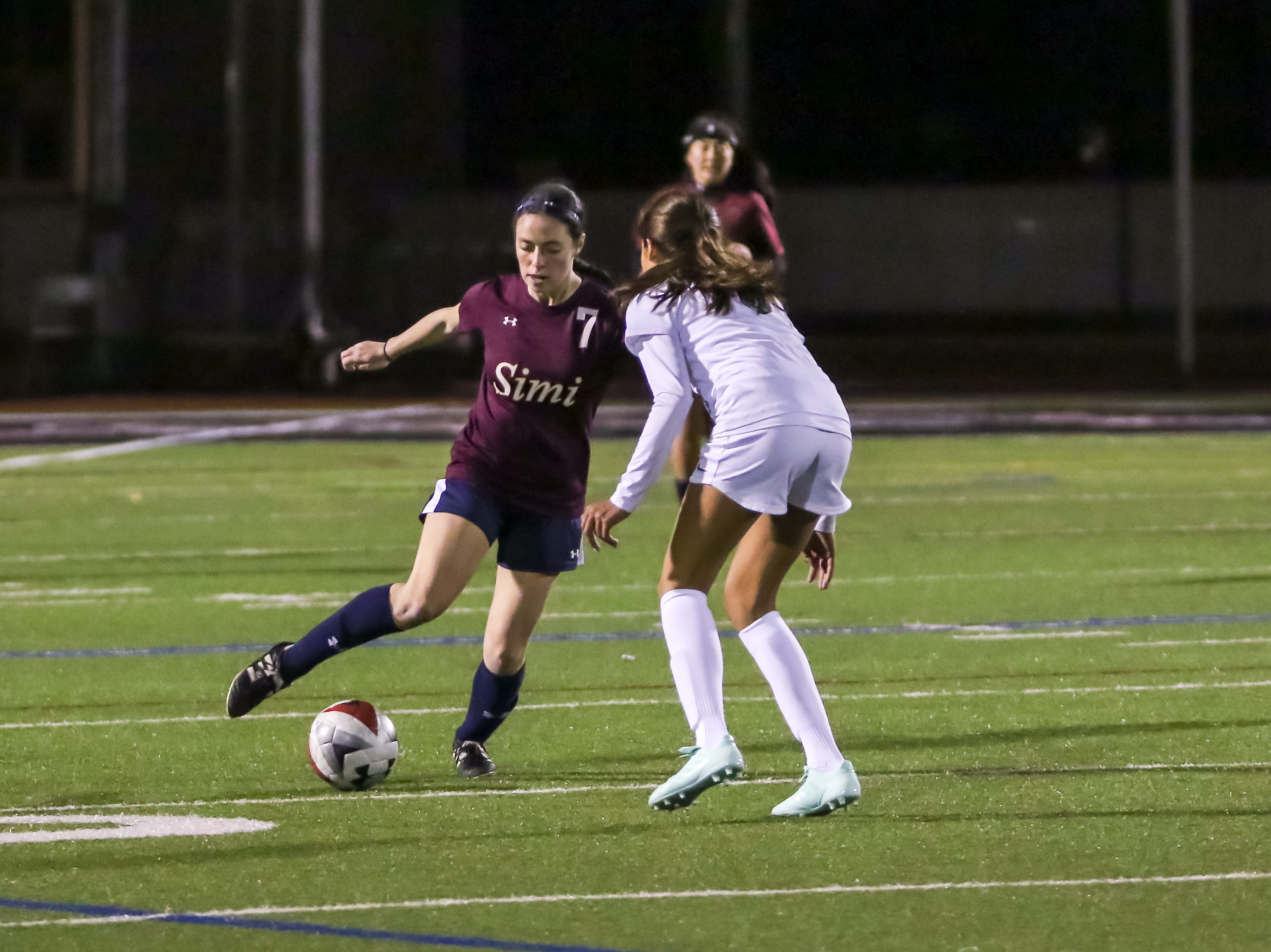 Simi Valley's Amanda Crawford takes on a defender during Friday night's Ventura County versus Los Angeles County Senior Girls Soccer All-Star game at Oaks Christian's Thorson Stadium. Ventura County won, 1-0.
