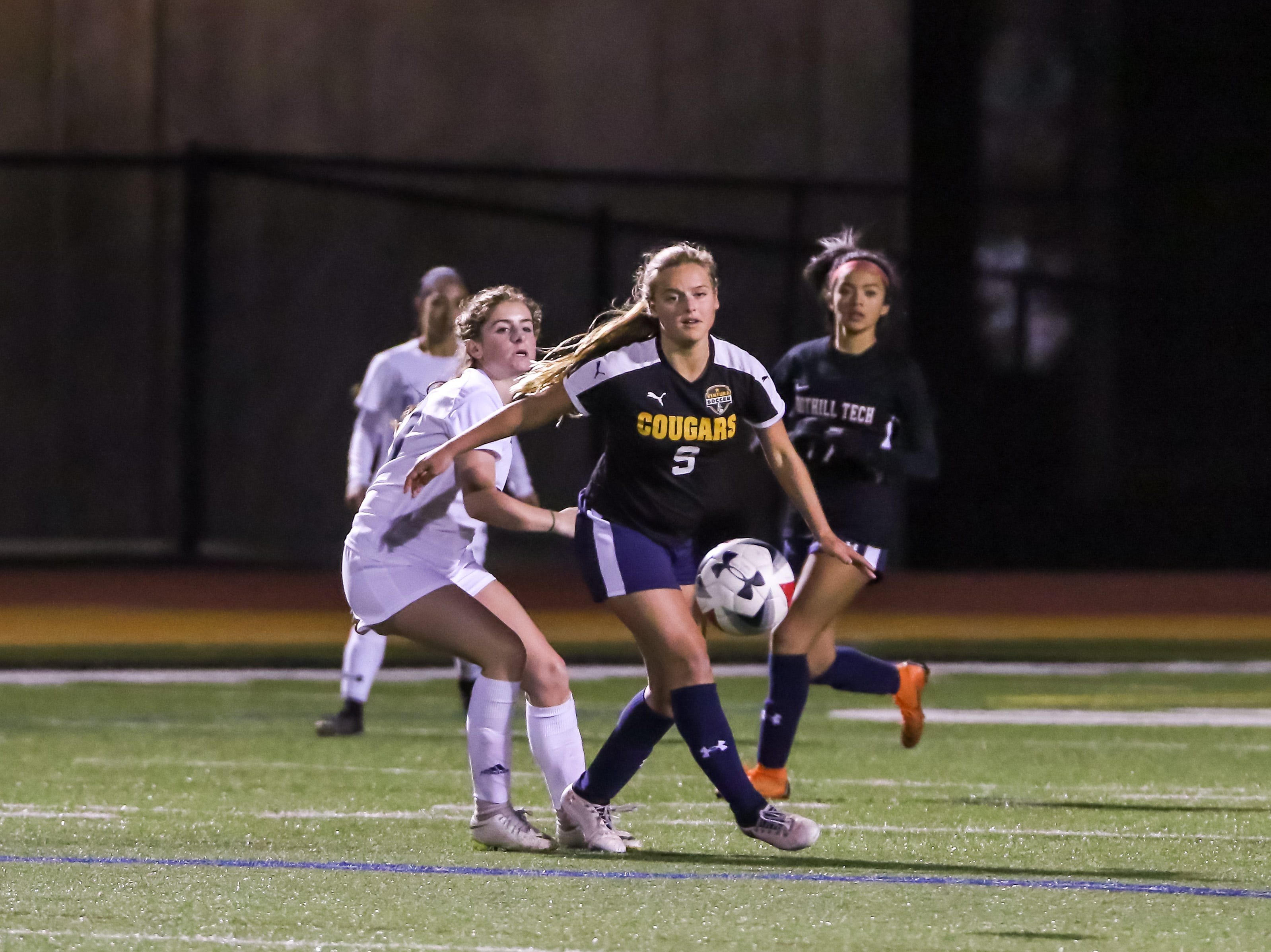 Ventura's Elieah Boyd looks upfield for a teammate on Friday night during the Ventura County versus Los Angeles County Senior Girls Soccer All-Star game at Oaks Christian's Thorson Stadium. Ventura County won, 1-0.