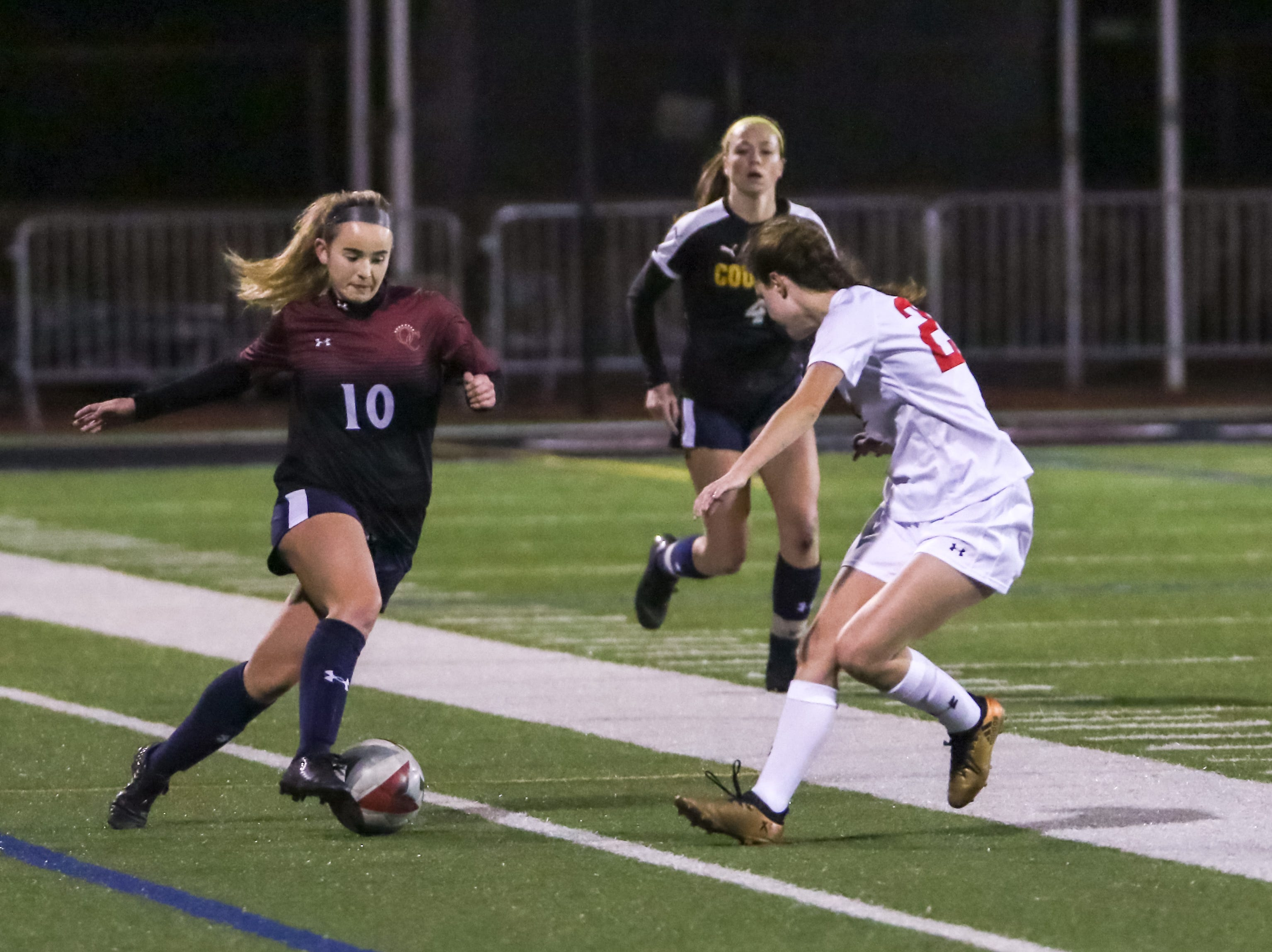 Oaks Christian's Madison Demijohn takes on an opponent during Friday night's Ventura County versus Los Angeles County Senior Girls Soccer All-Star game at Oaks Christian's Thorson Stadium. Ventura County won, 1-0.