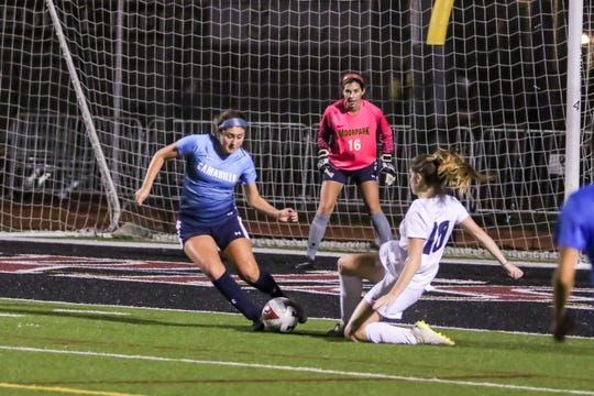 Camarillo's Alex Gonzalez clears a Los Angeles opportunity in front of Moorpark goalkeeper Felicia Neatherlin during Friday night's Ventura County versus Los Angeles County Senior Girls Soccer All-Star game at Oaks Christian's Thorson Stadium. Ventura County won, 1-0.