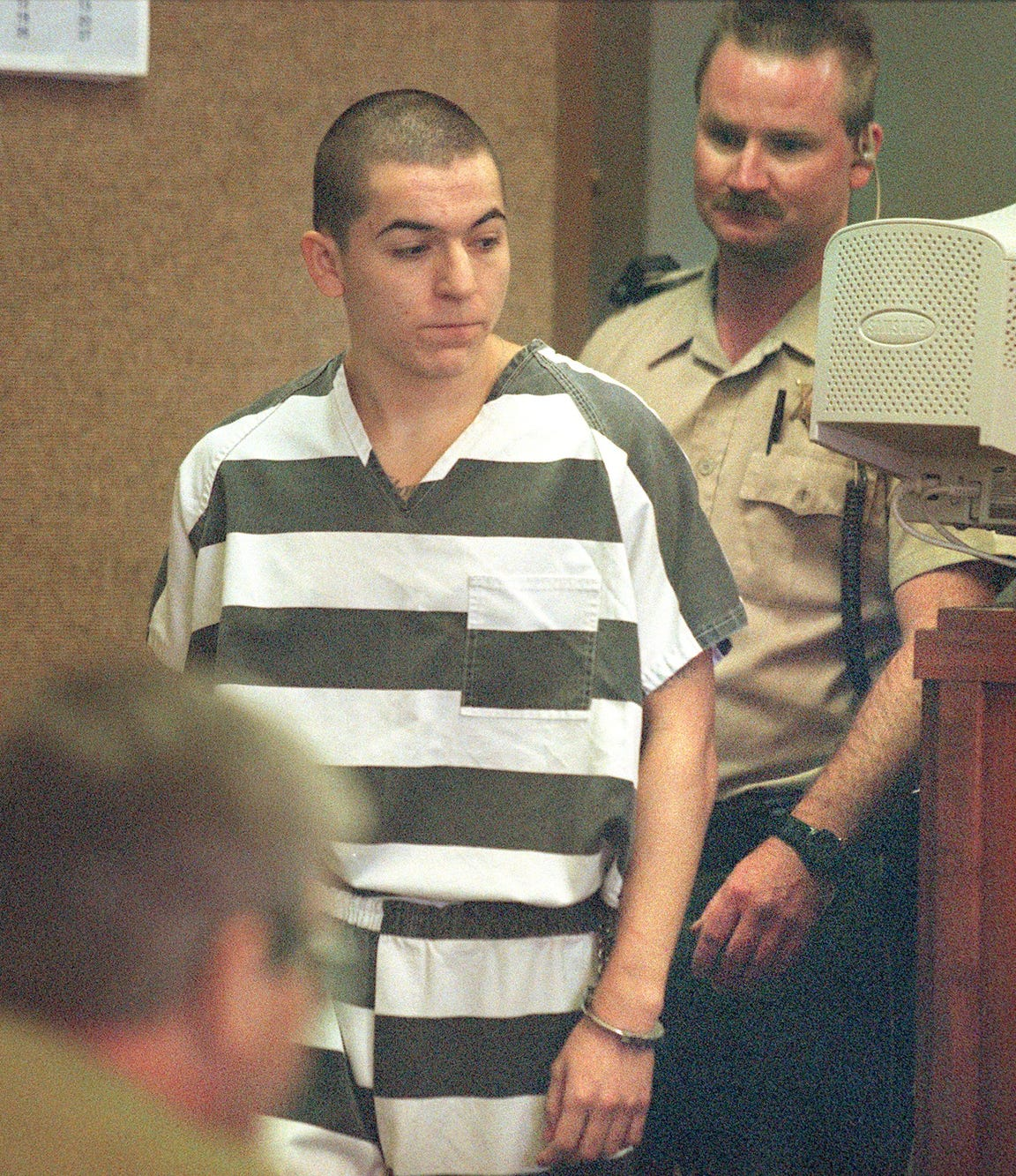 In this 2001 file photo, Samuel Espinoza is brought into Judge Darryl Ferguson's courtroom at the Tulare County Courthouse for sentencing for the shooting of 13-year-old Nancy Saechao.