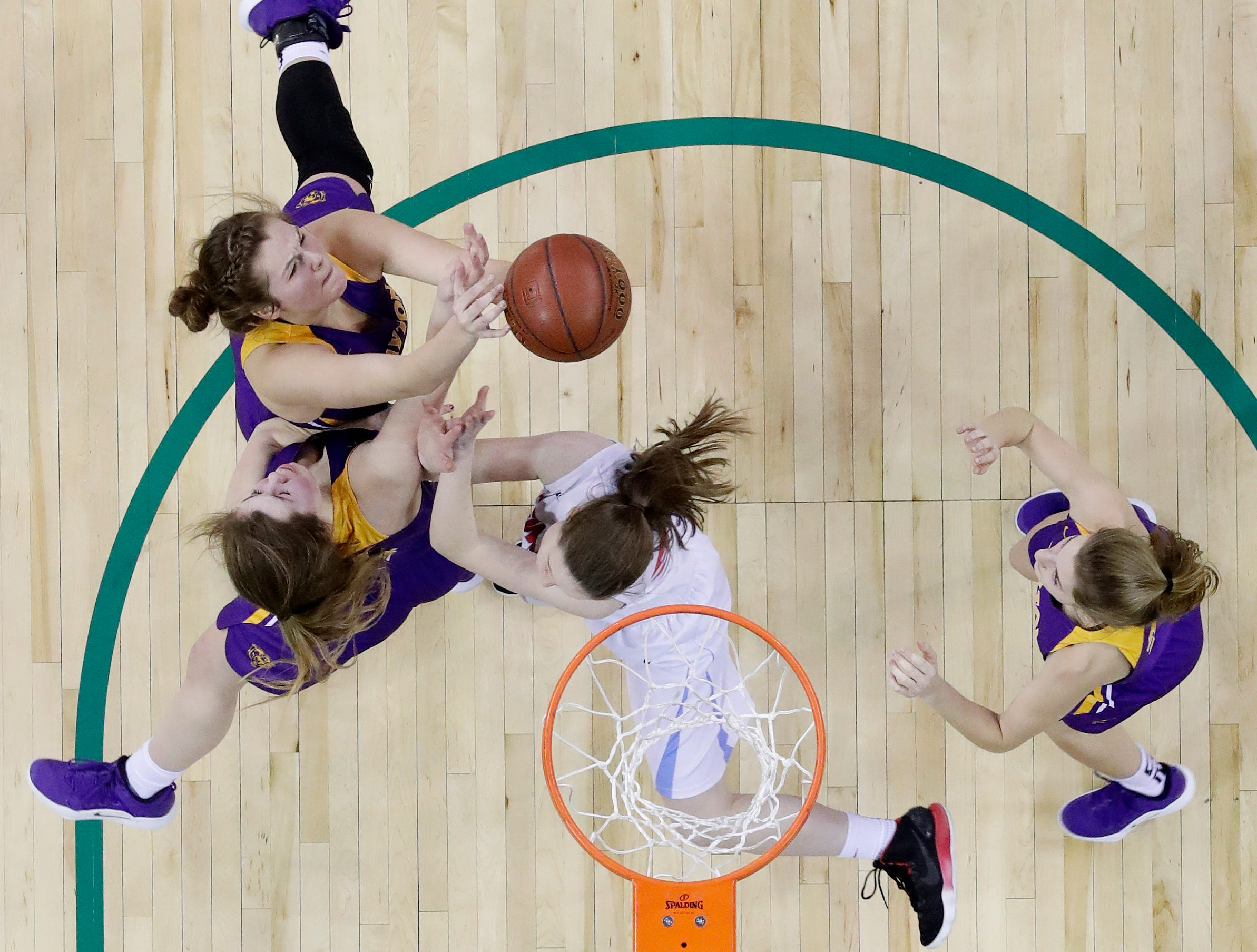Clayton's Alison Leslie and Kailey Ketz collide while competing with Wausau Newman Catholic's Alex Frankel in a Division 5 semifinal at the WIAA state girls basketball tournament at the Resch Center on Friday, March 8, 2019 in Ashwaubenon, Wis.